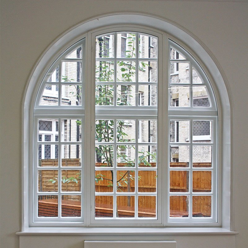 Beautiful curved arch original primary treated with bespoke secondary double glazing unit