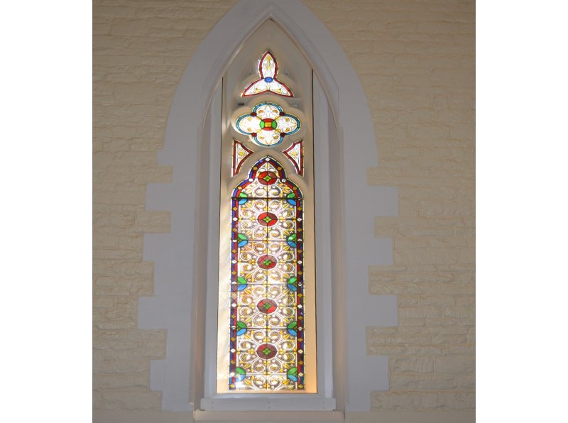 St Lukes Chapel at Oxford University. Stained glass window treated with Selectaglaze thermally enhancing secondary glazing
