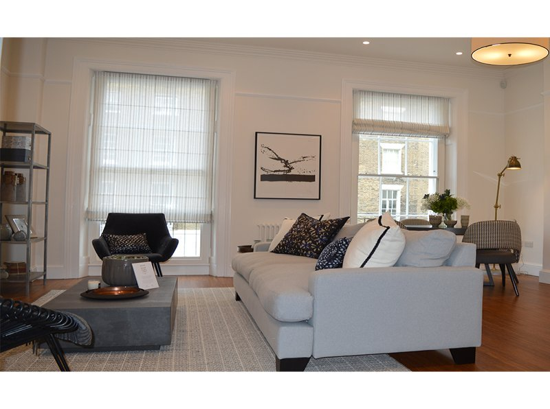 119 Ebury Street living room. Large sash windows with thermally enhanced secondary glazing with Spacia glass