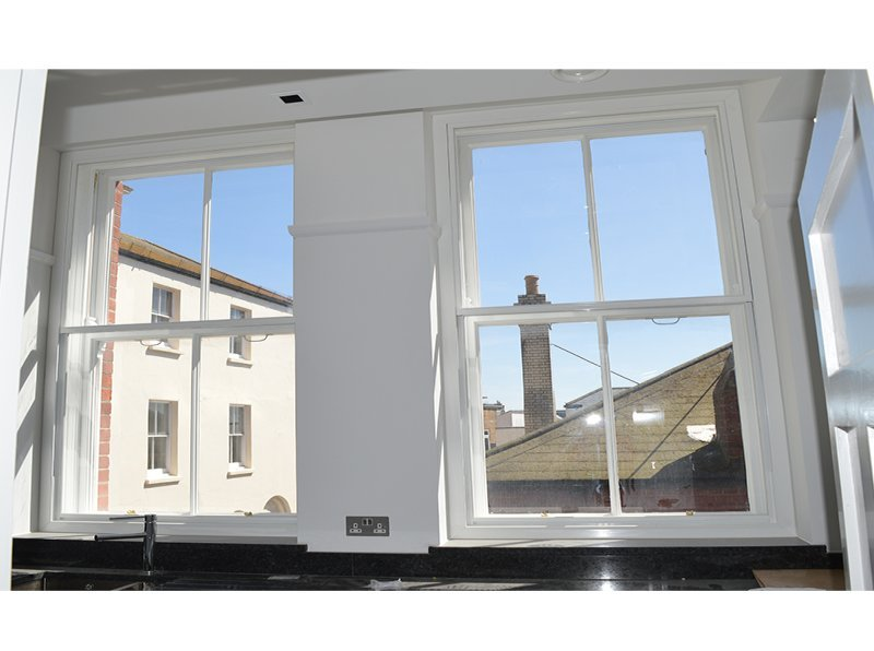Secondary glazing to make the kitchen and living area warmer for occupants