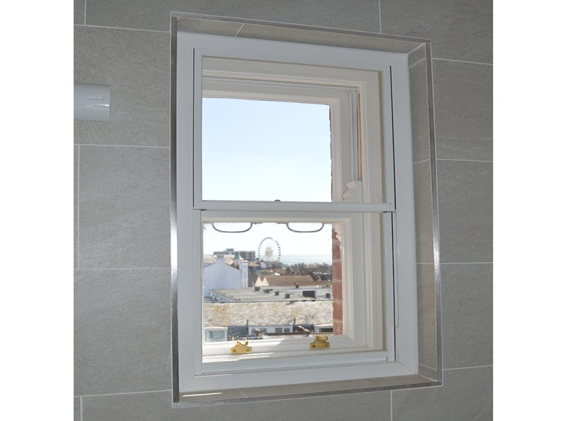 Close up of Selectaglaze secondary glazing for thermal improvement in the bathroom with views to the Brighton Eye