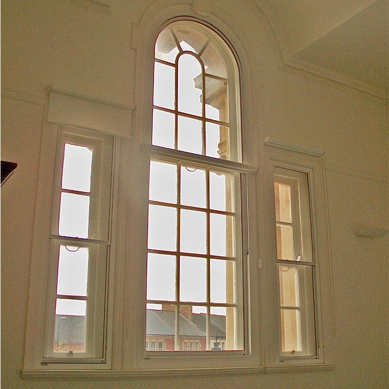 Feature art deco style windows at Barry Town Hall, Wales with Selectaglaze secondary glazing