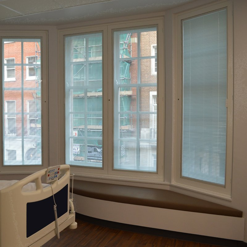 Sealed unit secondary glazing casements with integral blinds. Patient privacy and sound insulation at Fortius Clinic, Bentinck Street