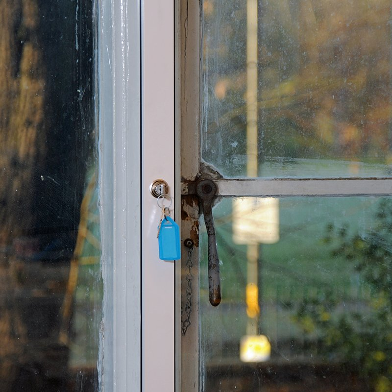 Close up of Selectaglaze secondary glazing with plunge lock and key