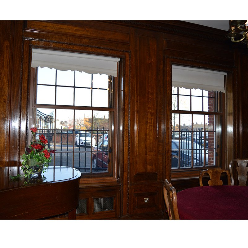 Braintree Town Hall meeting room with wood grain effect Selectaglaze secondary glazing