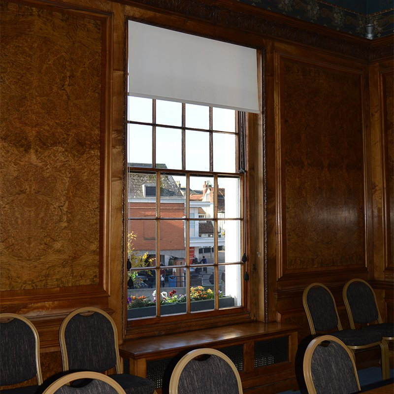 Wood panelled function room at Braintree Town Hall with wood grain effect secondary glazing from Selectaglaze