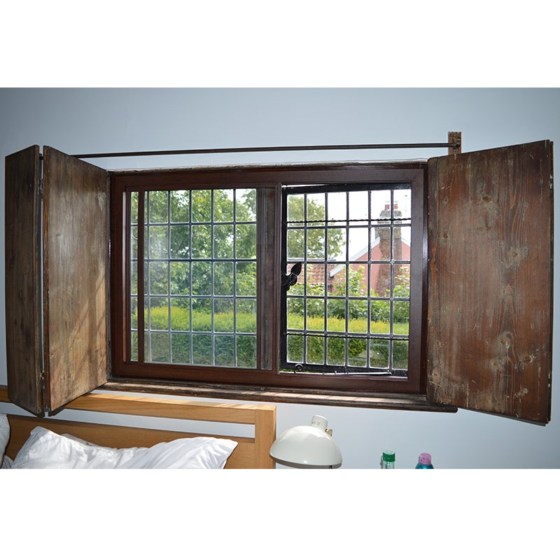 Bronze secondary glazing with original wooden shutters