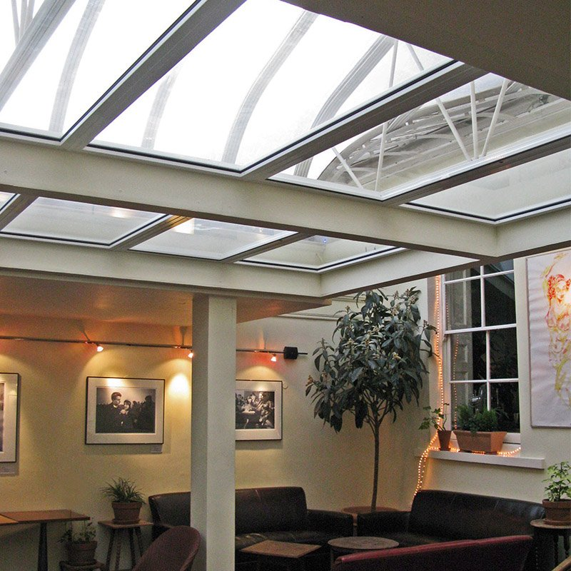 Interior lounge with roof lights treated with secondary glazing to prevent heat loss and contain the noise from the bar