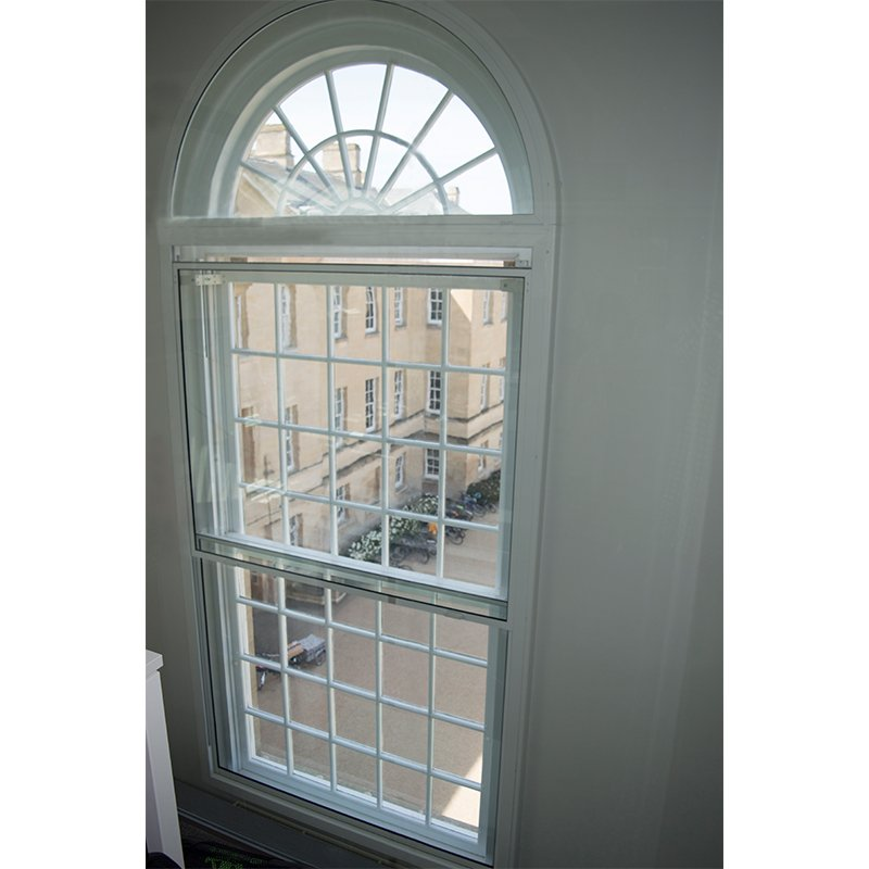 Large motorised vertical sliding secondary glazing at Outpatients building Oxford University