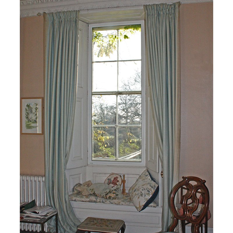 Window seat niche with heat retaining secondary glazing for a grade 2 listed residence