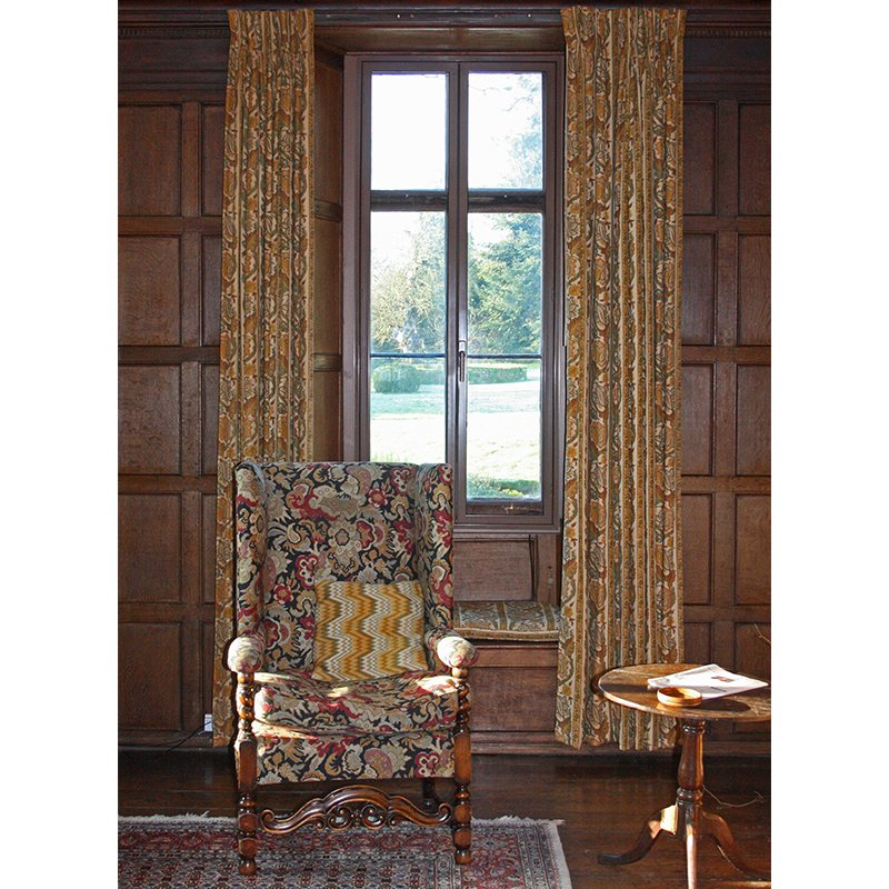 Denton House wooden panelled sitting room with colour matched brown secondary glazing