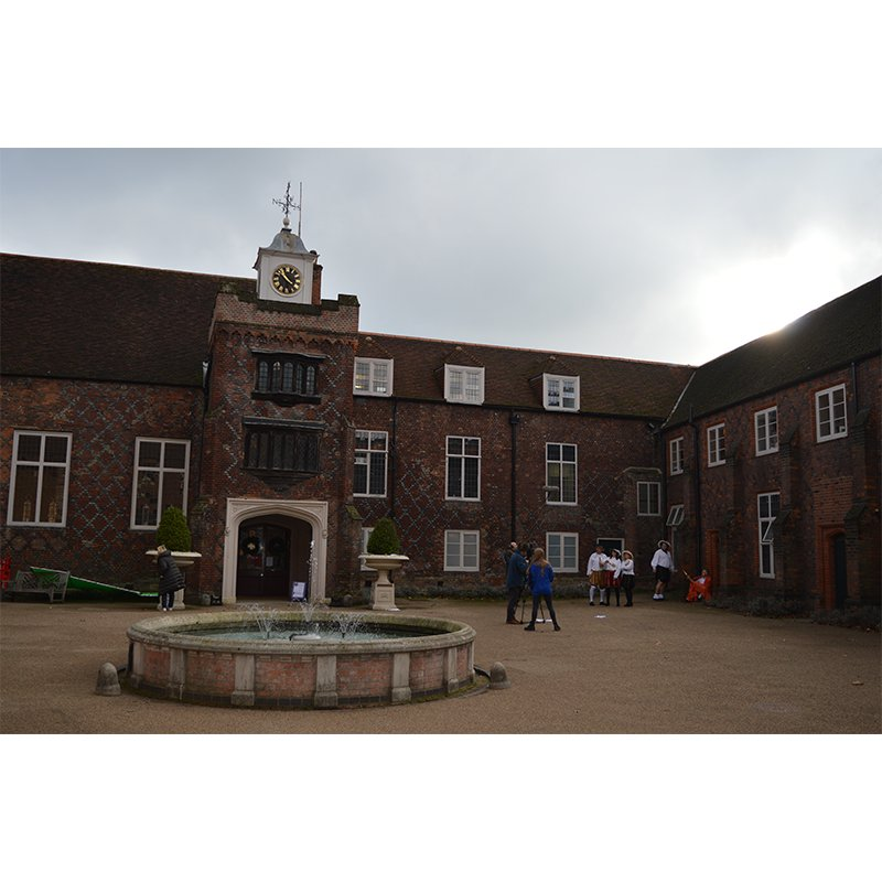 The quadrangle at Fulham Palace with tudor windows and beautiful fountain