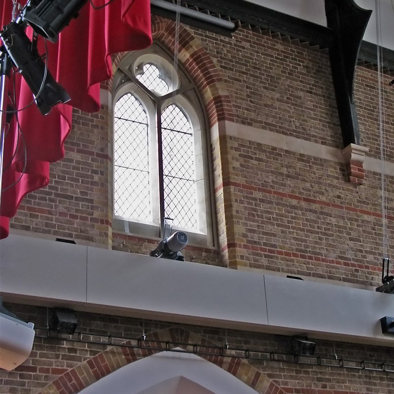 Church conversion to performing arts space at Latymer and Godolphin School with noise insulating secondary glazing