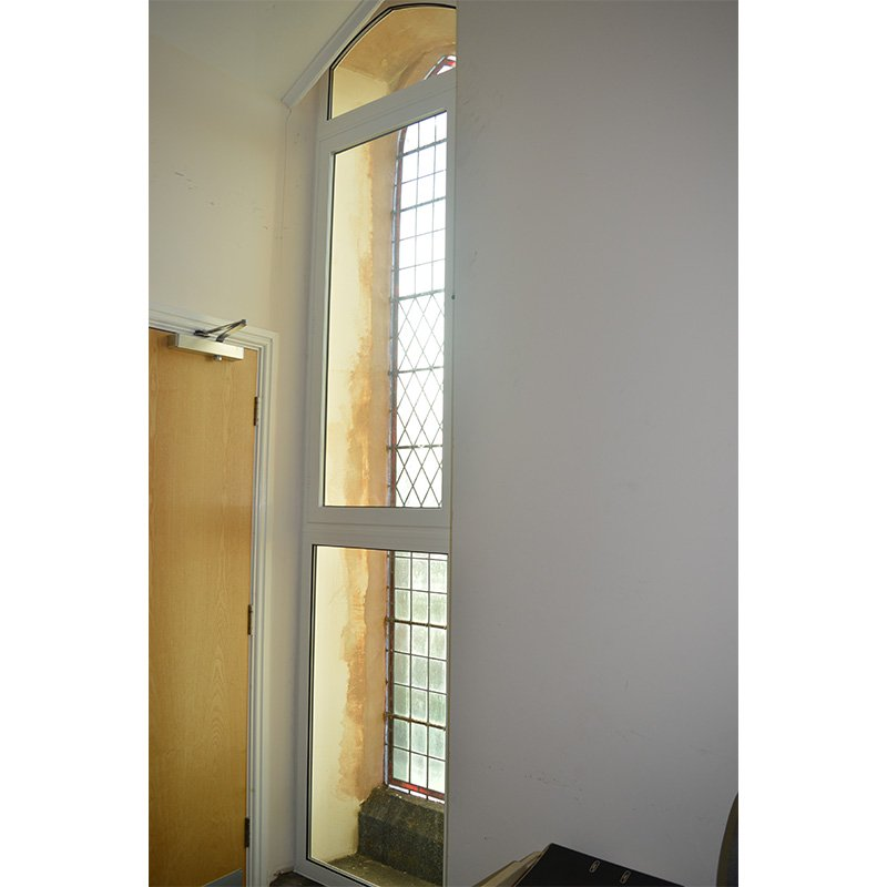 The tall lancet window in Hindmarsh Hall, treated with the build up of three separate units; the bottom pane was a series 40 fixed light, centre panel was a series 41 side hung casement and top panel was a gothic arched series 40 fixed light