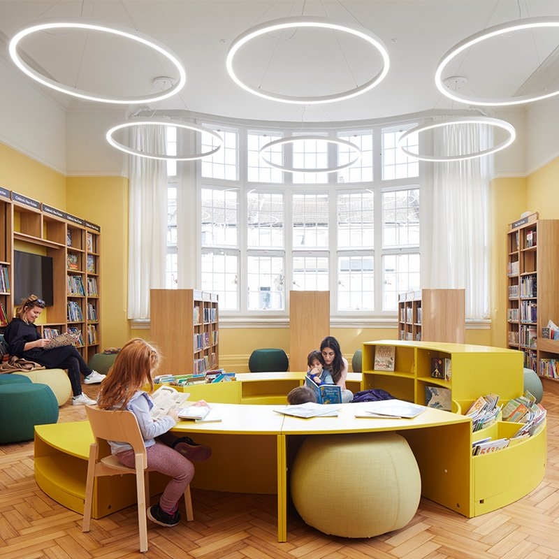 Internal view of the large sweeping bow windows with retrofit Selectaglaze secondary glazing, making Plumstead Library's reading room more energy efficient and acoustically sound.