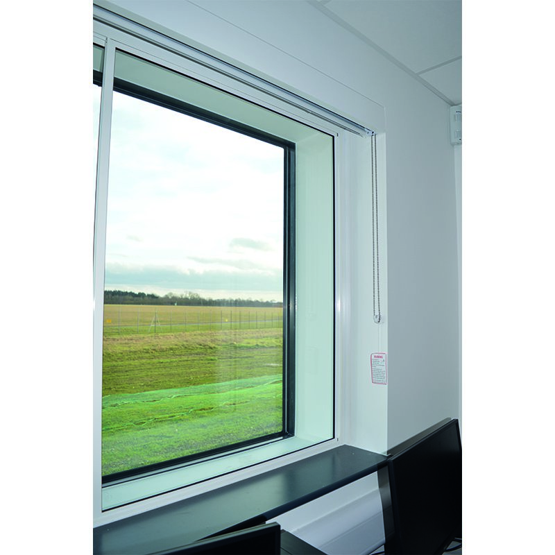Selectaglaze series 10 horizontal sliding against primary double glazing, to provide acoustic insulation in a college at the end of Stansted Airport runway