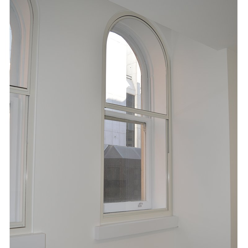 Curved head vertical sliding secondary glazing