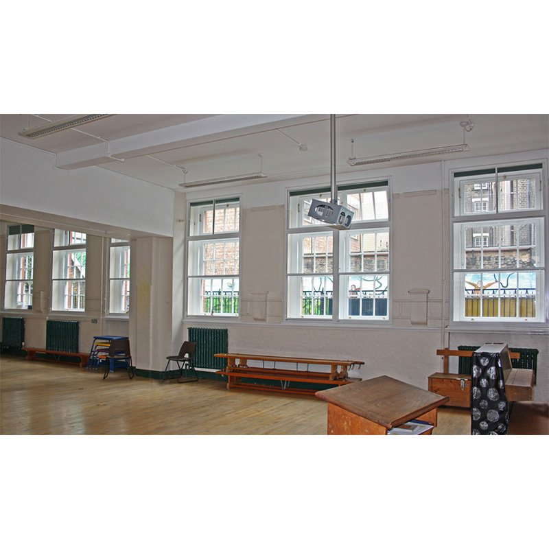 Main hall at St Josephs school with secondary glazing window treatments for sound insulation