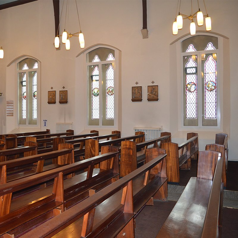 The gothic arched clerestory windows in St Patricks Church with Selectaglaze acoustic secondary glazing