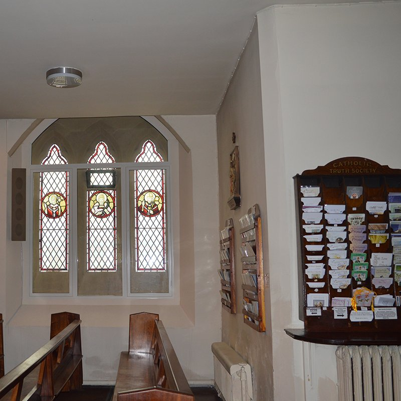 Gothic arched window at St Patricks Church with Selectaglaze Series 41 side hug casements transom coupled to Series 46 curved fixed light secondary glazing for acoustic insulation