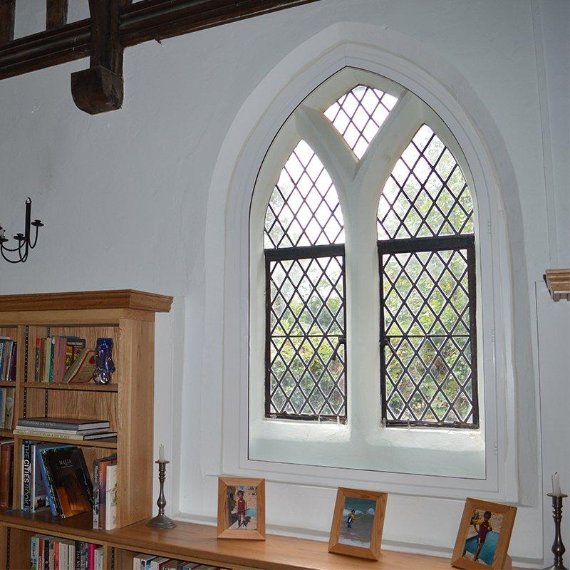 Grade II Listed the Priory with gothic arched head secondary glazing in dining room