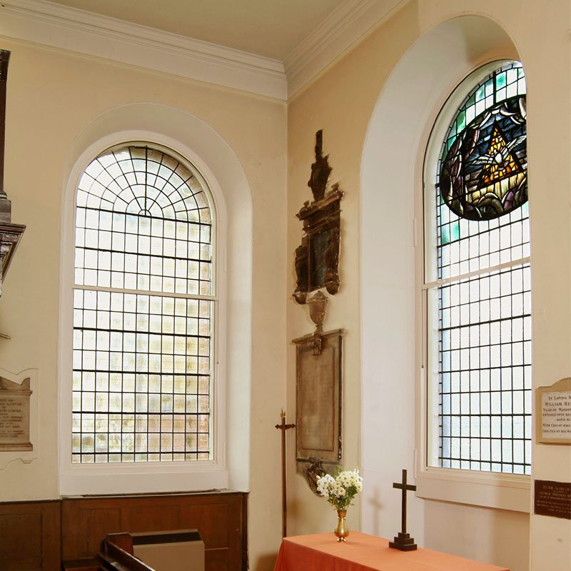 All Saints Church with arched series 90 vertical sliding secondary glazing
