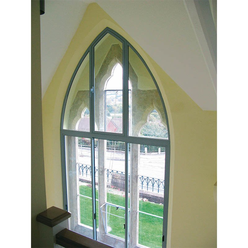 Gothic arched secondary glazing in Northleze Primary School residential conversion