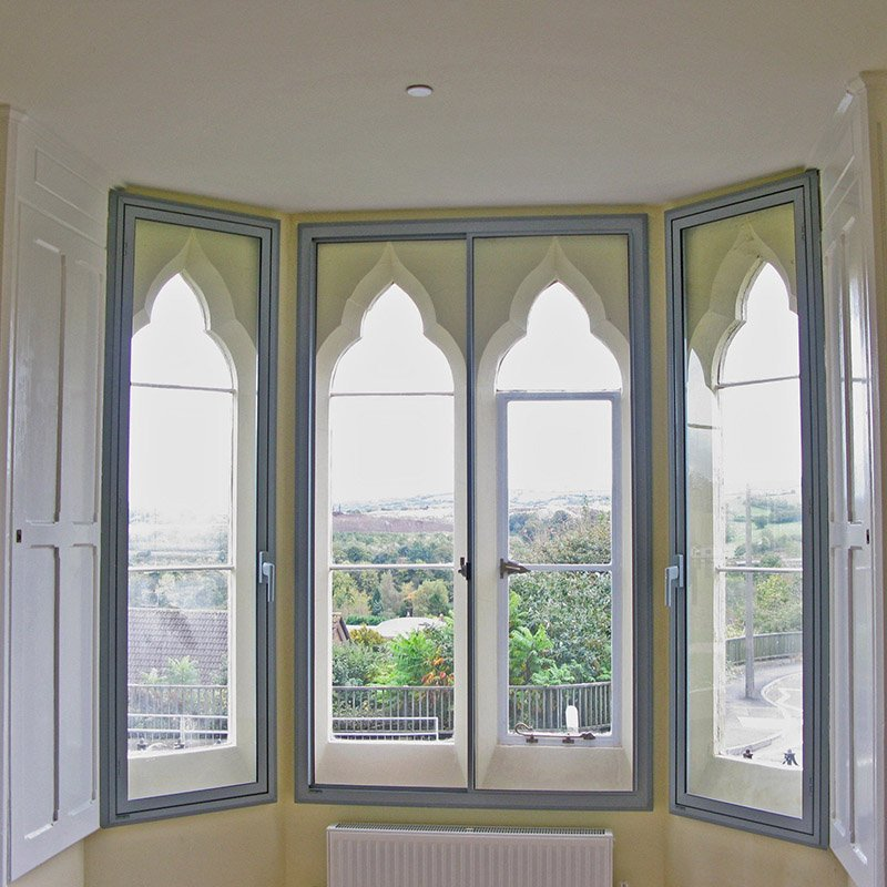 Beautiful gothic arched primary doors treated with Selectagalze secondary glazing