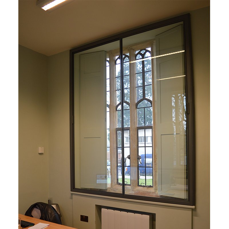 Horizontal sliding secondary glazing with access to original shutters in Grade II Listed Gatehouse, Bristol.