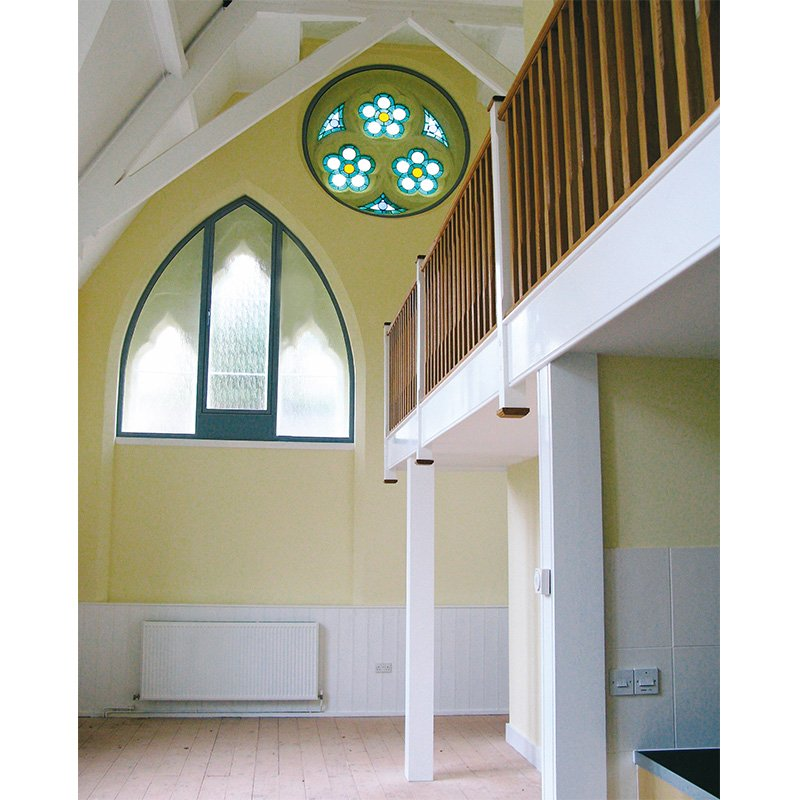 Arched window and round window treated with secondary double glazing