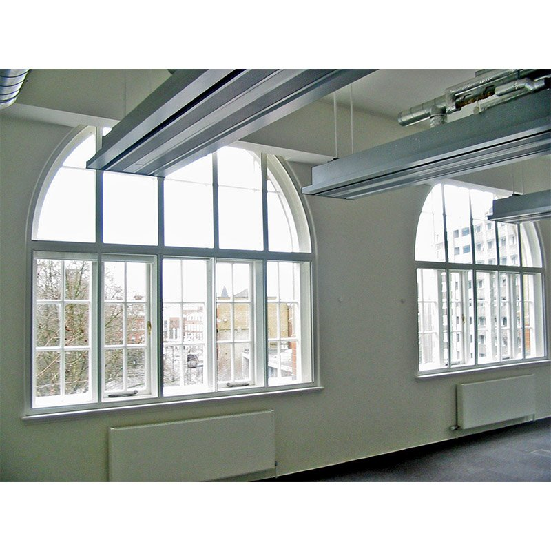 Large arched secondary glazed units to make the learning environment more comfortable at City University