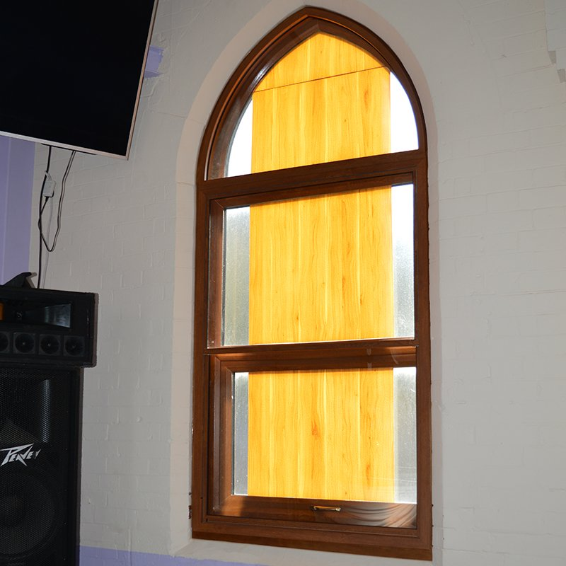 Bronze anodized arched head with combined secondary glazed units, including series 20 vertical slider and series 46 fixed light
