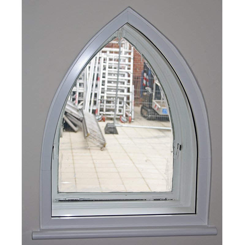 Small arched window at St Pauls Church with Selectaglaze secondary glazing