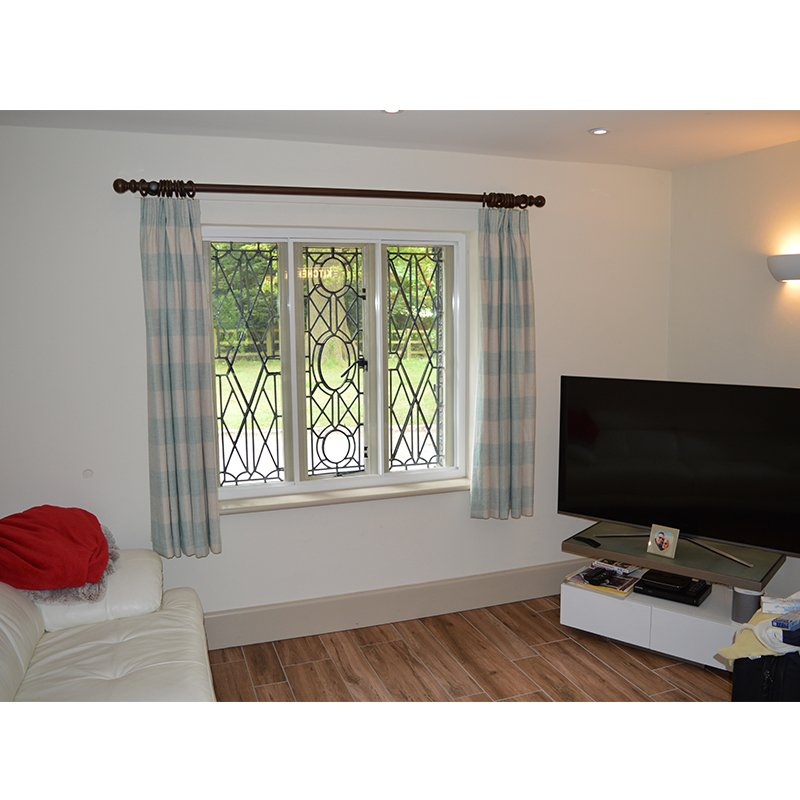 Leaded light windows in bedroom with Selectaglaze secondary glazing