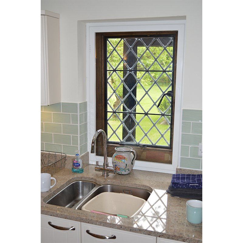 Entrance lodge kitchen window with a secondary glazed inward opening casement